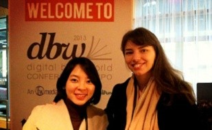 "Image is of two women who are Uconn Human Rights alumni. Hoin Choi is on the left and Tanyella is on the right. They are at posing in front of a poster that reads ""Welcome to dbw - digital books world conference"""