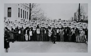 Image is of Tennessee sanitation workers protesting