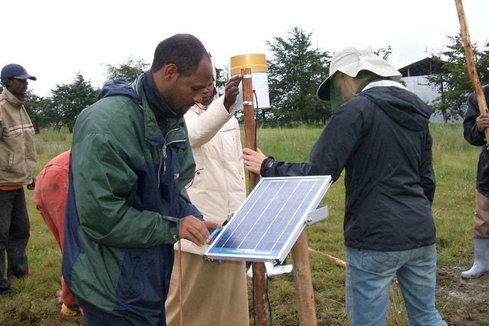 Engineers installing solar panel